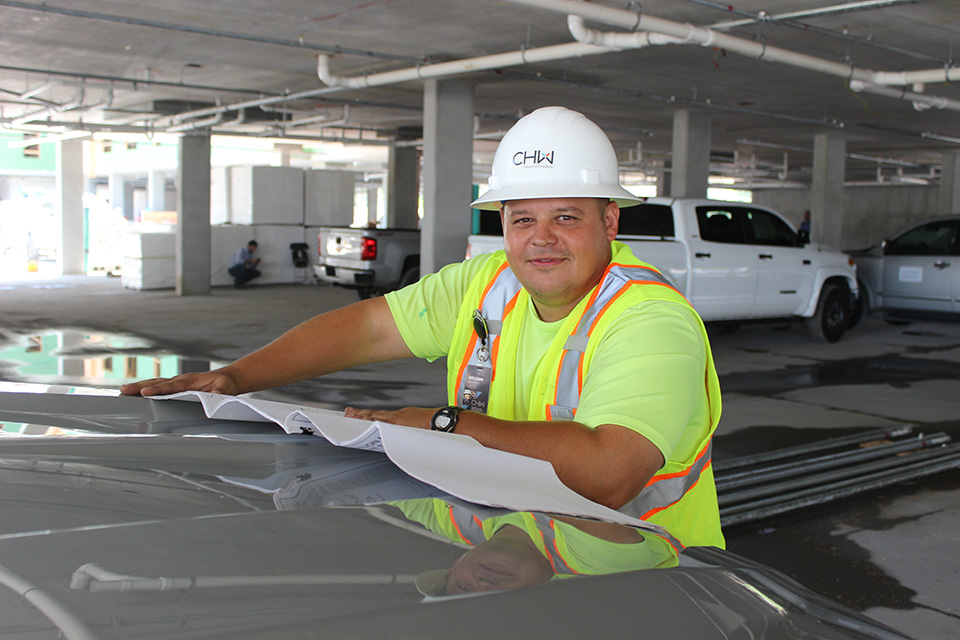 Land Surveyor at the Lofts on Jefferson Topping out in Jacksonville, FL