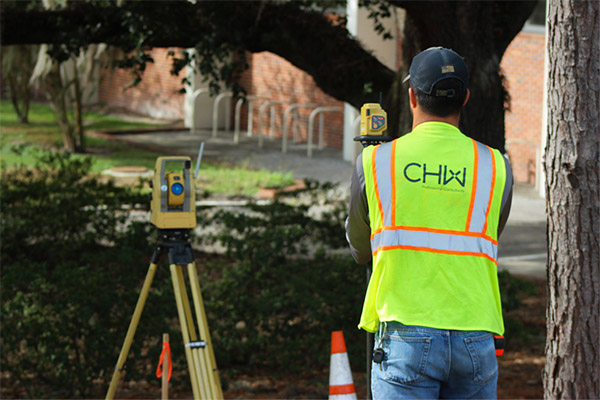CHW Land Surveyor surveying the site of the future DSIT Building at the University of Florida in Gainesville, FL